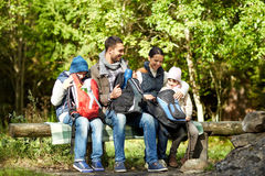 Happy family with backpacks and thermos at camp Stock Images