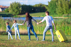 Happy family with baggage ready for traveling outdoors Royalty Free Stock Photography
