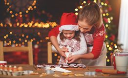 Happy family bake christmas cookies. Happy funny mother and child bake christmas cookies royalty free stock photo