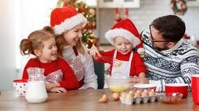 Happy family bake christmas cookies royalty free stock photos