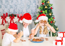 Happy family baking Christmas cookies Stock Photos