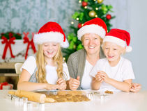 Happy family baking Christmas cookies Royalty Free Stock Image