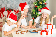 Happy family baking Christmas cookies Stock Image