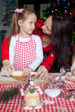 Happy family baking Christmas gingerbread cookies Royalty Free Stock Photo