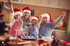 Happy family baking cookies on xmas Royalty Free Stock Images