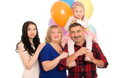 Happy family with balloons Stock Images