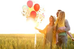Happy family with balloons outdoors on sunny day. Happy family with colorful balloons outdoors on sunny day Stock Images