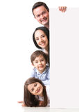 Happy family with a banner Royalty Free Stock Images