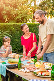 Happy family on barbecue royalty free stock photography