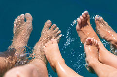 Happy family. Bare feets in the water of the sea boy, mother, father Royalty Free Stock Photo