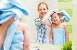 Happy family in bathroom. mother of a child with towel dry hair Royalty Free Stock Images