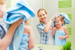 Happy family in bathroom. mother of a child with towel dry hair Stock Images