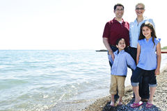 Happy family at beach Stock Photos