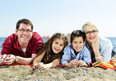 Happy family at beach Stock Photo