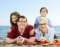 Happy family at beach Stock Image