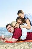 Happy family at beach Stock Photo