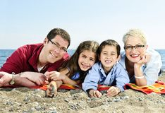Happy family at beach Royalty Free Stock Photos
