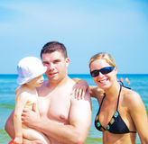 Happy family on the beach Royalty Free Stock Photo