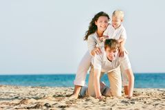 Happy family on beach Stock Image