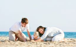 Happy family on beach Stock Photography