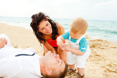 Happy family at the beach Stock Image