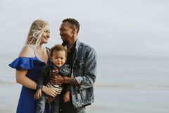 Happy family at a beach royalty free stock images