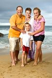 Happy family at the beach Royalty Free Stock Photo