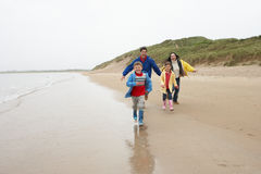 Happy family on beach Stock Images