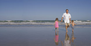 Happy family on a beach Royalty Free Stock Photo
