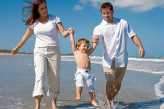 Happy family on a beach Stock Photos