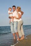 Happy family at the beach. Happy family having fun at the beach royalty free stock image