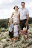 Happy family at the beach Stock Photography
