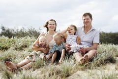 Happy family at the beach Stock Images