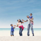 Happy family at beach Stock Photography