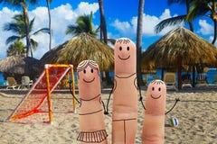 Happy family on the beach. Beachfront football Royalty Free Stock Image
