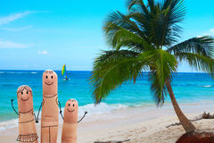 Happy family on the beach. Exotic vacation Royalty Free Stock Photography