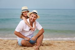 Happy family at beach. father and child daughter hug at sea stock images