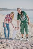 Happy family on the beach Stock Photos