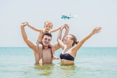 Happy family on the beach and landing aircraft. Traveling with c stock images