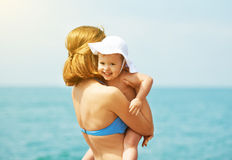 Happy family on the beach. mother and baby daughter Royalty Free Stock Photos