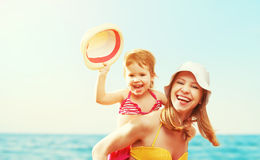 Happy family on the beach. mother and baby daughter Stock Images