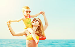 Happy family on the beach. mother and baby daughter Stock Photo