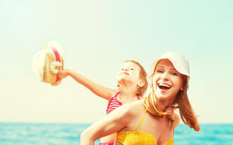 Happy family on the beach. mother and baby daughter Royalty Free Stock Photo