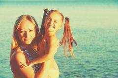 Happy family on the beach. mother and baby daughter Royalty Free Stock Images