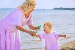 Happy family on the beach. Royalty Free Stock Photos