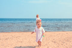 Happy family on the beach. Royalty Free Stock Image