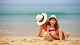 Happy family at beach. mother and child daughter hug at sea stock images
