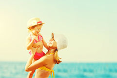 Happy family on beach. mother and child daughter Stock Images
