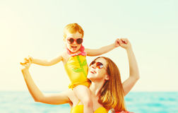 Happy family on the beach. mother and child daughter Royalty Free Stock Photos