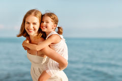 Happy family at beach. mother hugging child daughter Royalty Free Stock Image
